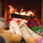 fireplace with family's feet