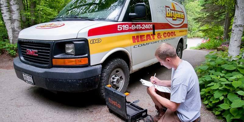 Bryan's Fuel technician working outside van