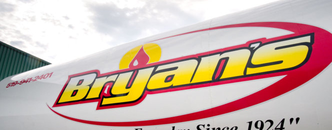 Bryan's Fuel logo on the side of company van