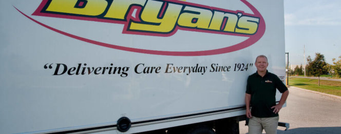 What Is A Propane Fixed Price Program?- Bryan's Fuel team member standing by their truck
