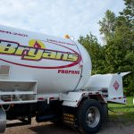 A Bryan's Fuel truck delivery fuel to a home.