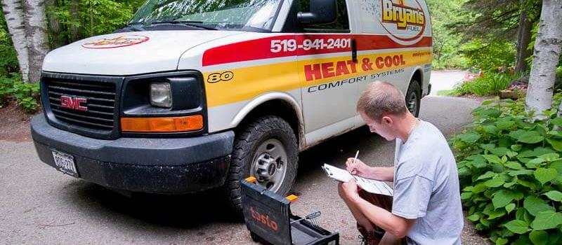 Bryan's Fuel technician working outside van